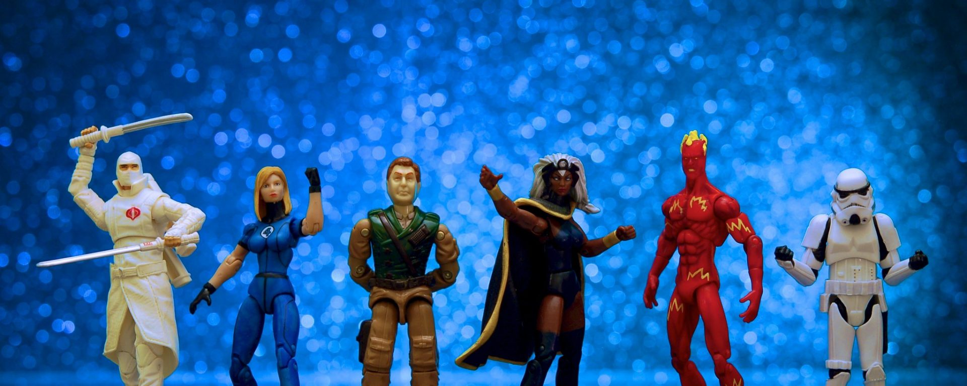 Six action figures stand together as a group in a line