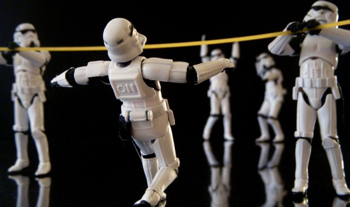Storm Troopers do the limbo while others cheer them on