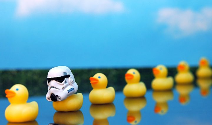 A row of rubber ducks with one that is wearing a Darth Vader helmet to symbolize an error in a sequence