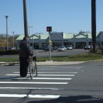 Man and Bicycle Crossing Glen Cove Road