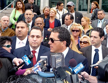 State Senator Hiram Monserrate after his conviction in State Supreme Court in Queens in October. Among his outspoken supporters is Marta Flores-Vazquez, on steps in red shirt and blue jacket.