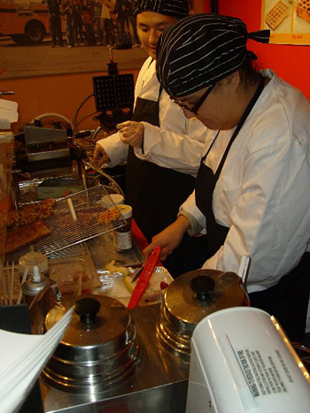 Cooks prepare the stand's award-winning waffles.