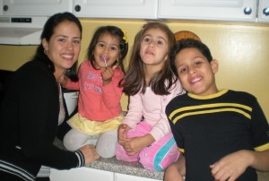Twenty-four-year-old Colombian immigrant Angélica Acosta, far left, and her three children.
