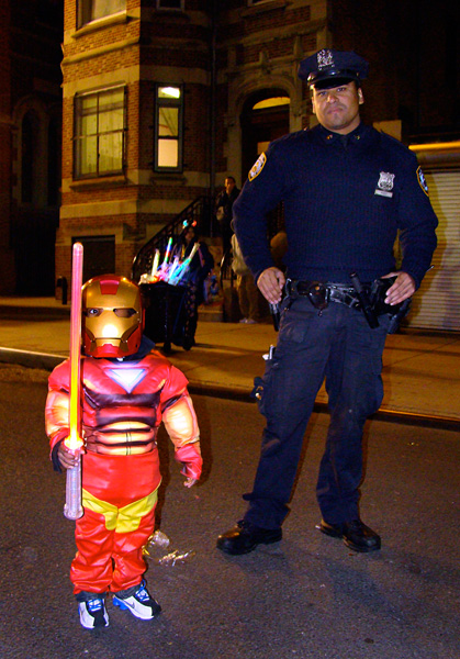 With reinforcements nearby, a 3-year-old Iron Man joins the fun.