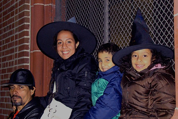 Julio and Rena Fernandez and their children Fanny and Ana take in their first New South Bronx Halloween Parade.