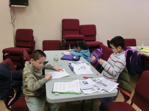 At the after-school program of the Chinese Evangel Mission Church on the Lower East Side, helping children with homework is a major priority.