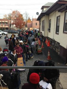 People wait outside Bronx Bethany Church to pick up food from the pantry. Photo by Ashleigh Baker