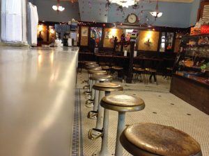 The marble counter and wooden stools in Eddie's Sweet Shop are over 90 years old. Photo by Thomas Sheubert