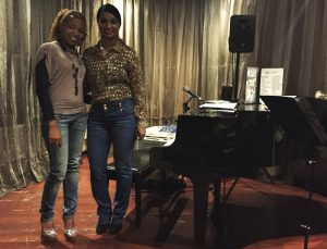 Betty Moreno and Monika Rodriguez play and sing for tourist crowds around Havana.