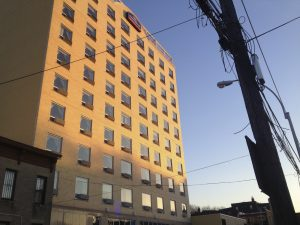 New hotels, including this Howard Johnson, are changing the face of the neighborhood but not bringing many jobs.