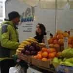 Anu Mohammed serves a customer at his fruit cart on 23rd Street between Park and Third avenues