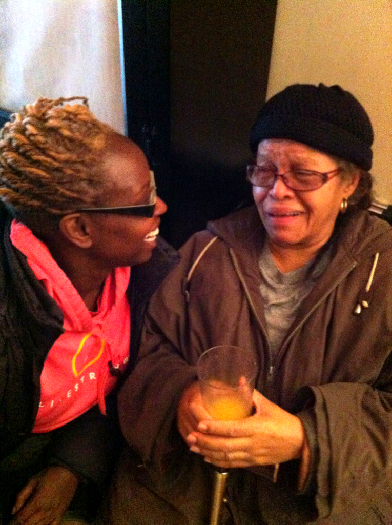 Baruch Professor Kyra Gaunt, Ph.D., left, found herself in three different storm shelters over the course of four days in the aftermath of Hurricane Sandy. Here, she laughs with Lucy, a woman she met during her experience.