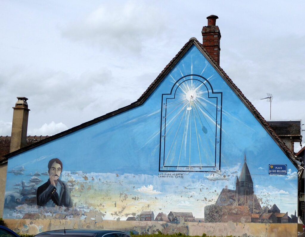 Image of mural of Marcel Proust on side of a house.