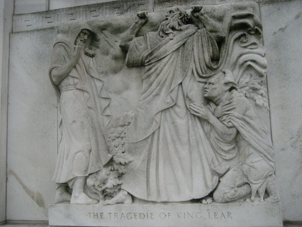 Image of relief carving in side of the building depicting a scene in King Lear.