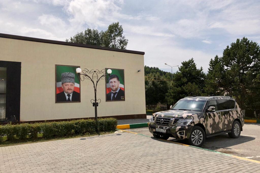 Portraits of Akhmad Kadyrov and Ramzan Kadyrov displayed on the outside of a building.
