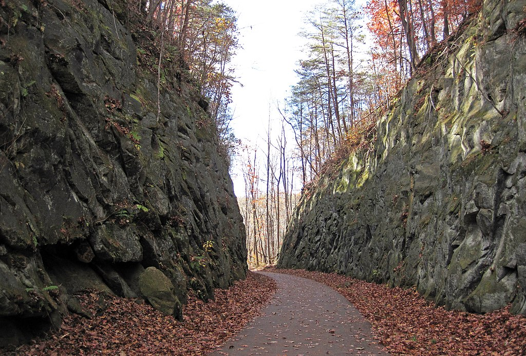 Image of a path between two large rock walls.