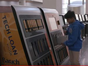 student using tech loan kiosk