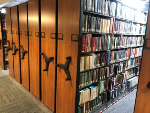 Compact shelving with books